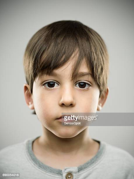 Cute little kid looking at camera