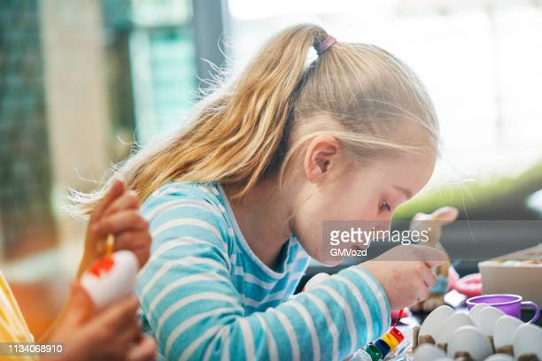 cute little kids coloring easter eggs - religious celebration stock pictures, royalty-free photos & images