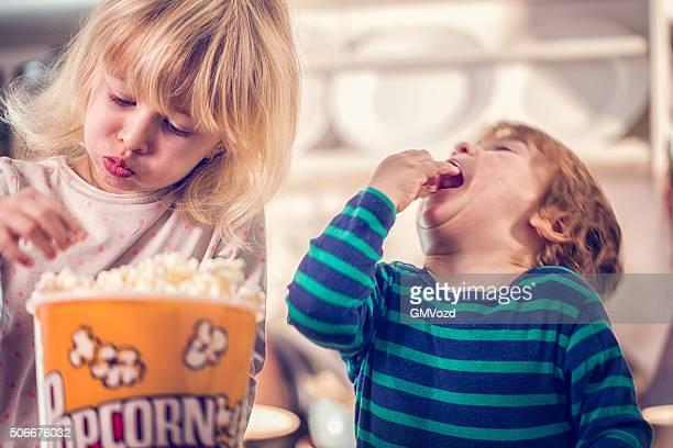 Cute Little Kids Eating Homemade Popcorn
