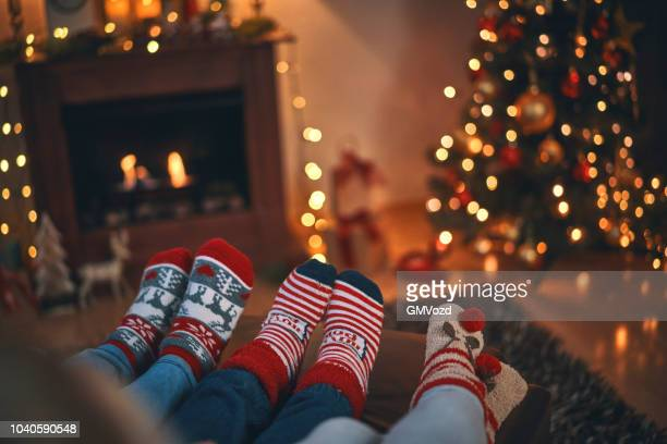 cute little kids in christmas socks sitting in a cosy christmas atmosphere - stockings photos stock pictures, royalty-free photos & images