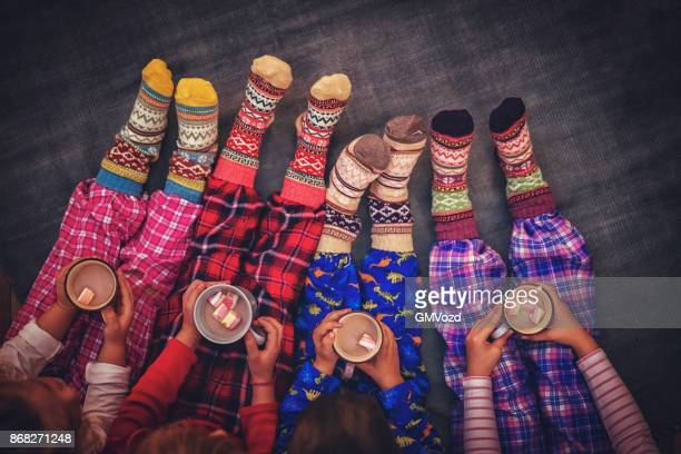 cute little kids in pyjamas and christmas socks drinking hot chocolate with marshmallows for christmas - sock stock pictures, royalty-free photos & images
