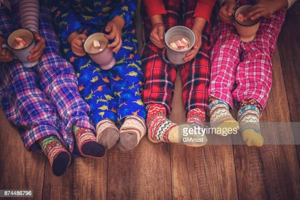cute little kids in pyjamas and christmas socks drinking hot chocolate with marshmallows for christmas - pajamas stock pictures, royalty-free photos & images