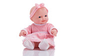 Cute little plastic baby doll isolated on white background