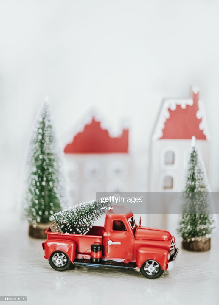 cute little red car toy truck with christmas tree on white wooden picture id1196064627