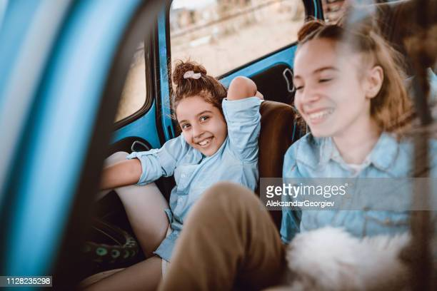 cute little sisters can't wait to start a trip - dog eats out girl stock pictures, royalty-free photos & images
