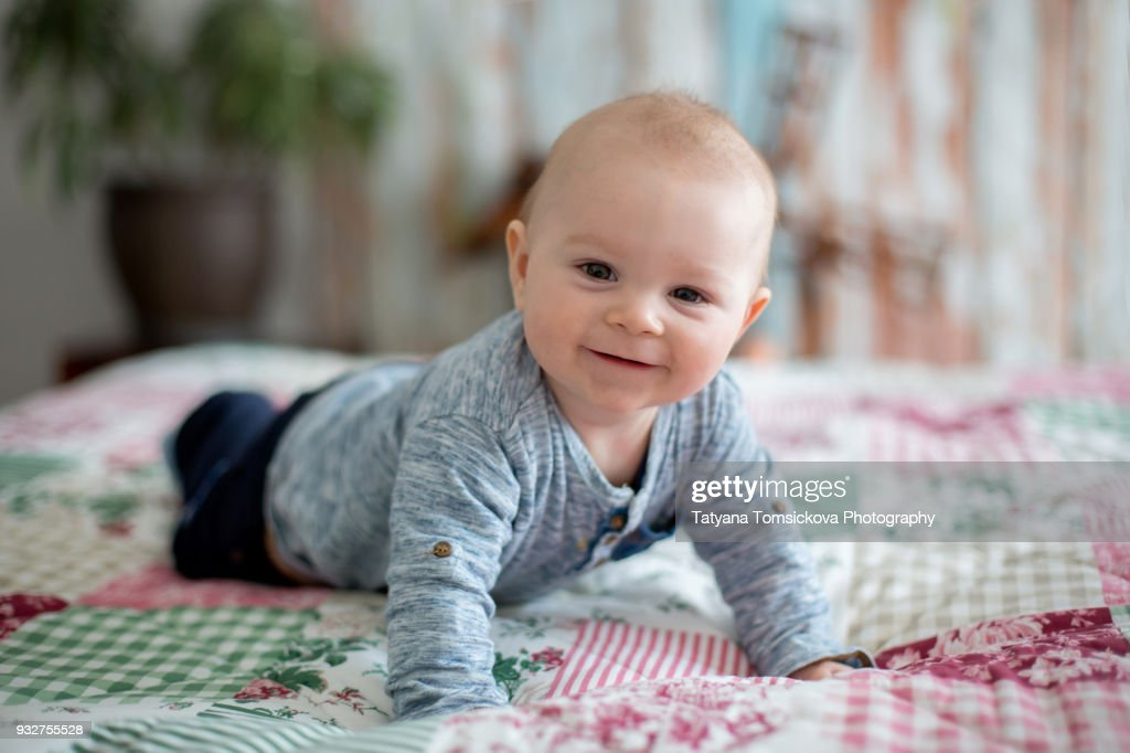 Cute Little Smiling Newborn Baby Boy Playing In The Morning Baby