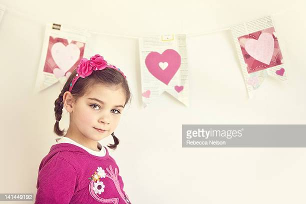 cute little standing in front of heart banner - rebecca nelson stock pictures, royalty-free photos & images