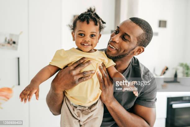 cute little toddler and supportive dad - emotional support stock pictures, royalty-free photos & images