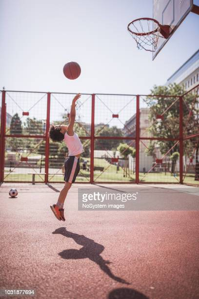 cute little-mixed race boy, playing basketball - shooting baskets stock pictures, royalty-free photos & images