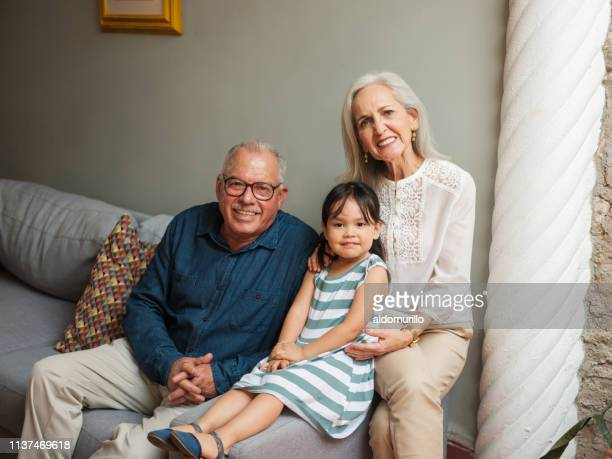 Cute Mexican grandparents and granddaughter