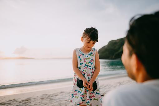 Cute mixed race preschool girl on beach at sunset, Okinawa, Japan - gettyimageskorea