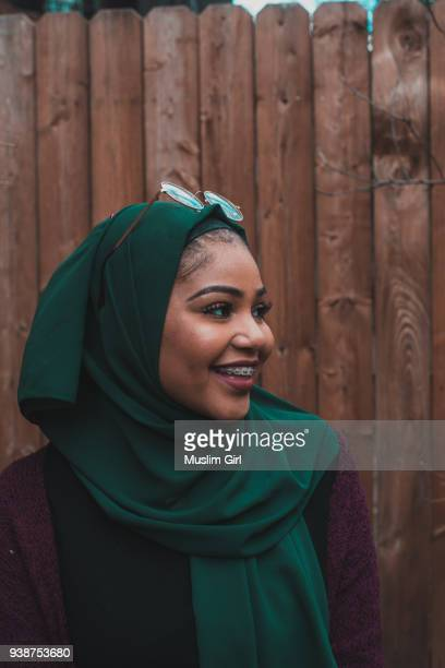 a cute muslim girl in jewel tone green hijab, smiling through her braces - muslimgirlcollection stock pictures, royalty-free photos & images