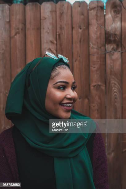 A Cute Muslim Girl in Jewel Tone Green Hijab, Smiling Through Her Braces