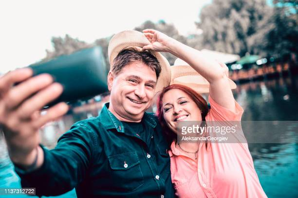 Cute Old Couple Taking Selfie Near Lake