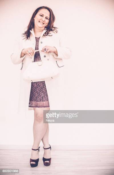 cute overweight young woman posing - fat women in high heels stock pictures, royalty-free photos & images