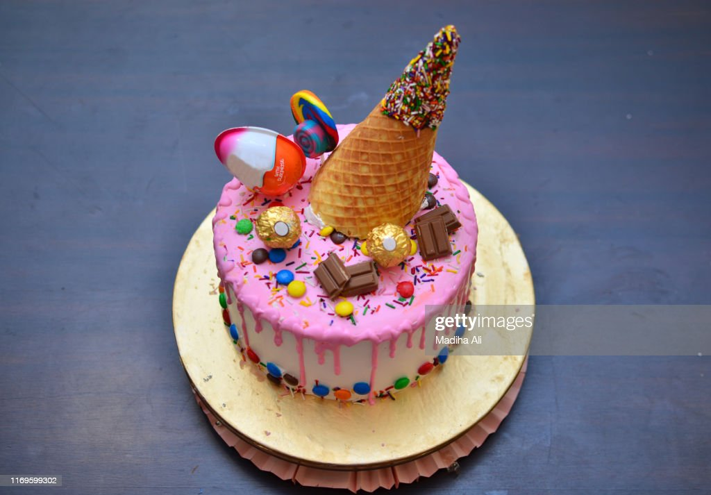 Superb A Cute Pink Birthday Cake With An Ice Cream Cone Waffle Wafer On Funny Birthday Cards Online Overcheapnameinfo
