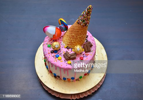 Surprising A Cute Pink Birthday Cake With An Ice Cream Cone Waffle Wafer On Funny Birthday Cards Online Overcheapnameinfo