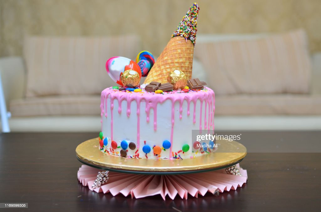 Awesome A Cute Pink Birthday Cake With An Ice Cream Cone Waffle Wafer On Funny Birthday Cards Online Overcheapnameinfo