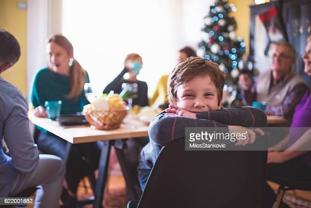 Cute Playful Boy at Christmas Dinner