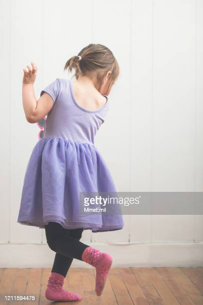 cute preschool girl dancing like no one is watching - mmeemil stock pictures, royalty-free photos & images