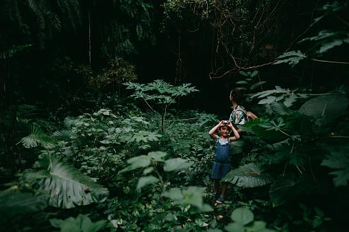 Cute preschool girl hiking in jungle with mother, Okinawa, Japan - gettyimageskorea