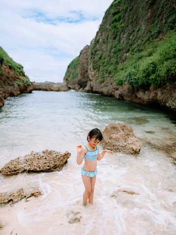 Cute preschool girl on secluded tropical beach, Okinawa, Japan - gettyimageskorea