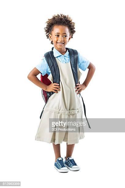 Cute private school kindergarten student standing with hands on hips