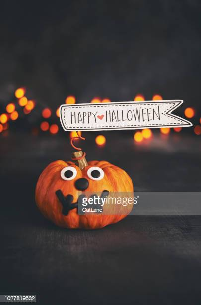 cute pumpkin character with handmade expression and happy halloween sign - candy corn stock photos and pictures