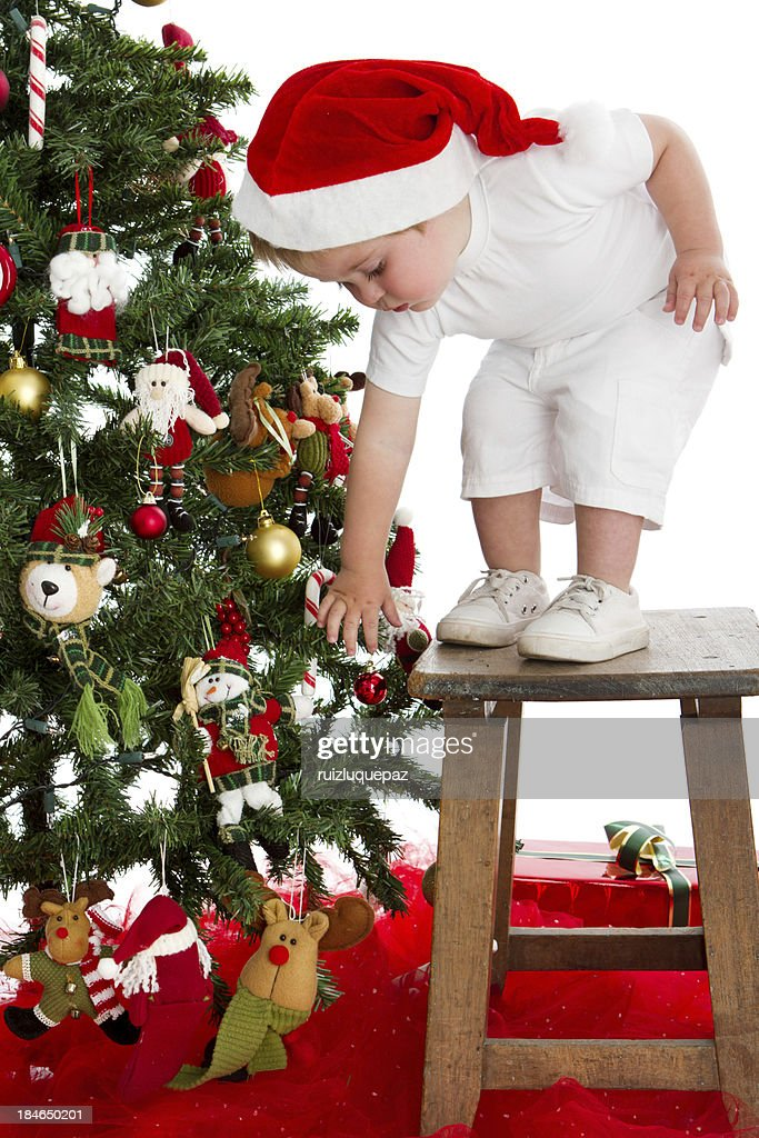 Cute Santa decorating Christmas tree : Stock Photo