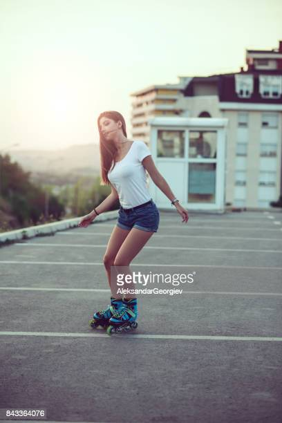 cute sensual female rollerblading on parking area - hot body girls stock photos and pictures