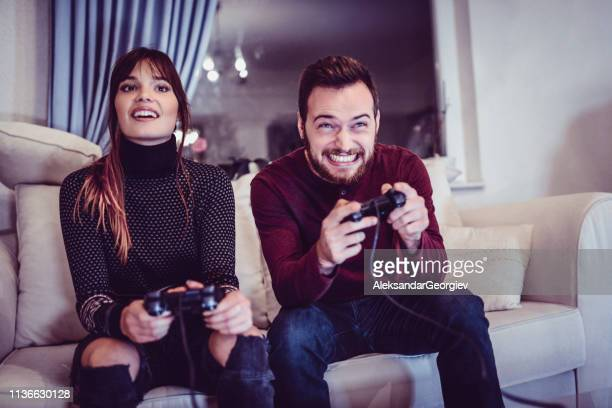 Cute Siblings Competing In Video Games At Home