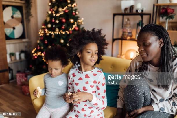 Cute sisters eating Christmas breakfast