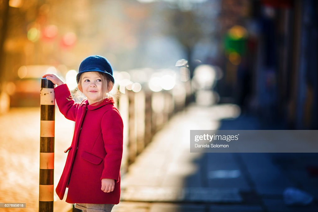 Cute smiling little girl with red coat and blue hat : Stock Photo