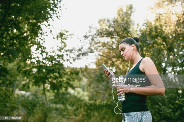 cute sports female playing her soundtrack for training - colors soundtrack stock pictures, royalty-free photos & images