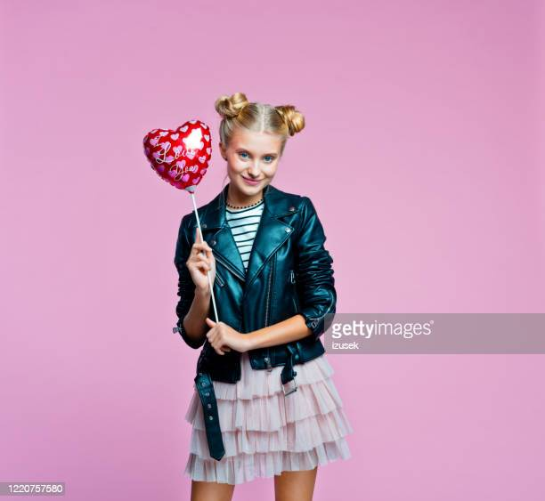 cute stylish teenege girl holding heart shaped balloon - embellished jacket stock pictures, royalty-free photos & images