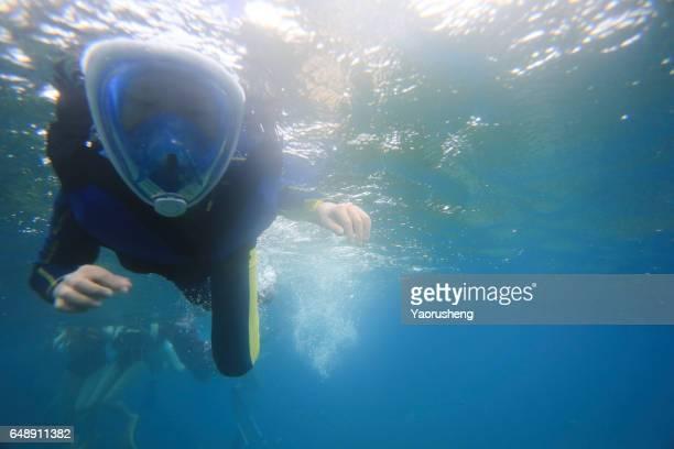 Cute teenage boy Snorkeling underwater