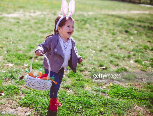 Cute toddler girl running and laughing