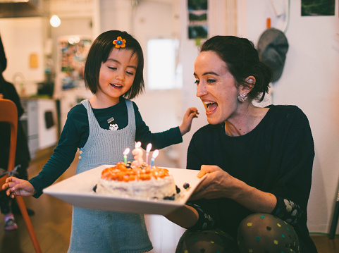 Cute toddler girl showing excitement with her birthday cake - gettyimageskorea