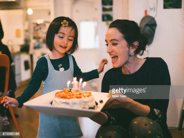 cute toddler girl showing excitement with her birthday cake - 誕生日 ストックフォトと画像