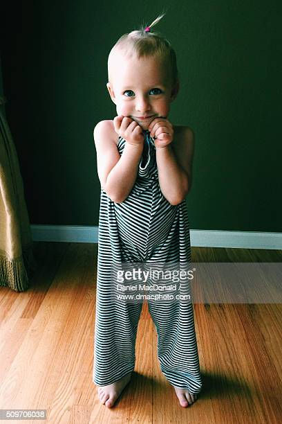 Cute toddler girl wearing her mother's too-big pajama bottoms