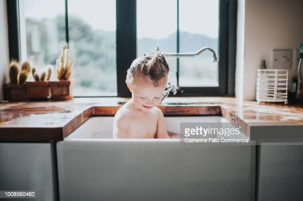 Cute Toddler having a Sink Bath