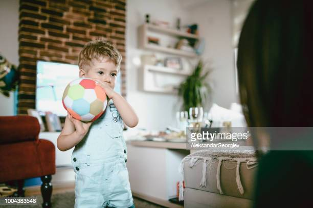 Cute Toddler Playing With Soccer Ball In Domestic Room
