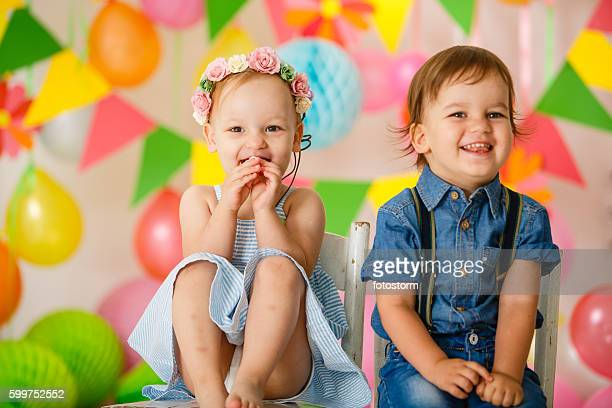cute toddler twins at birthday party - cute twins stock photos and pictures