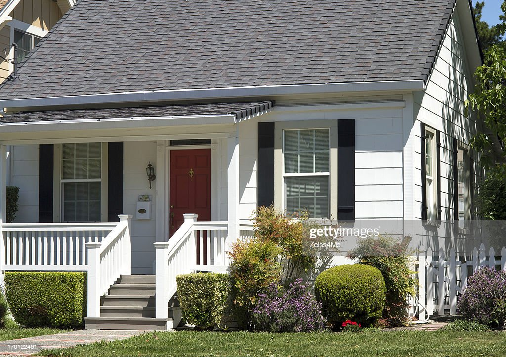 Cute traditional white house with front porch stock photo for Cute front porches