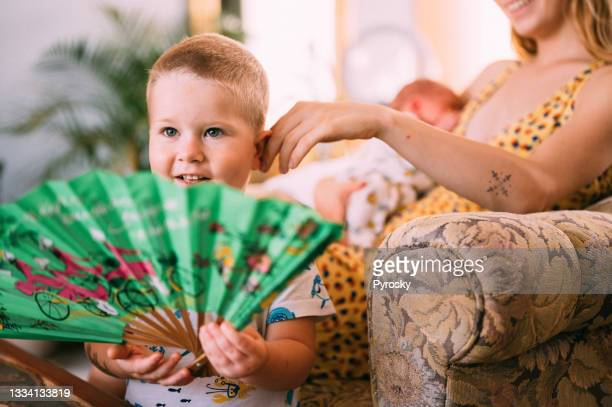 cute two years old boy at his home - 25 29 years stock pictures, royalty-free photos & images