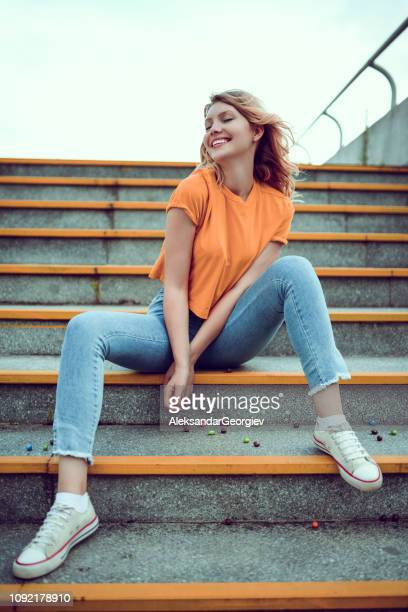 Cute Urban Female Posing On Stairs With Her Hair Blown