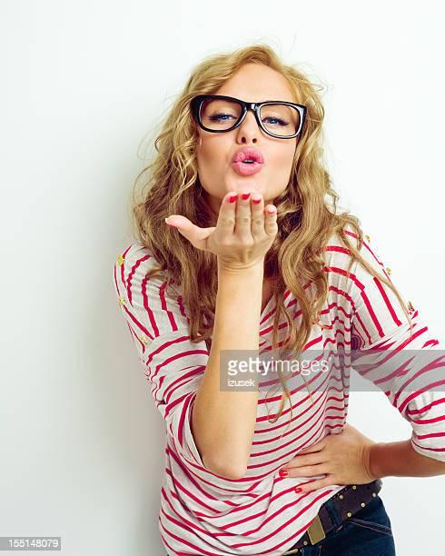 Cute woman blowing a kiss