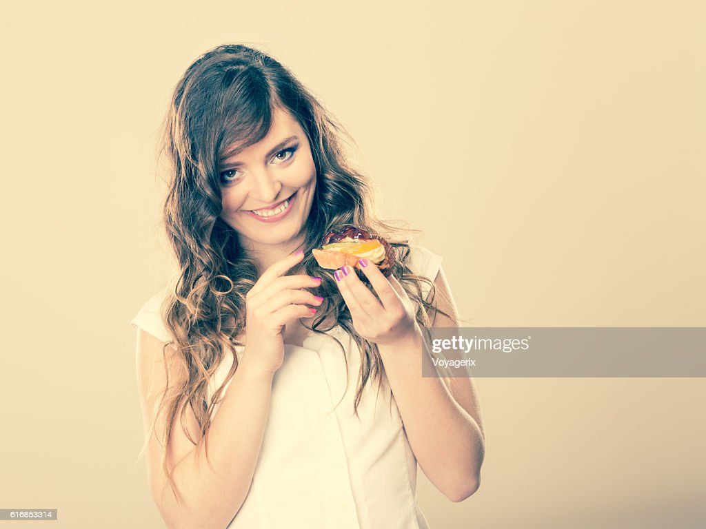 cute woman holds fruit cake in hand : Stock Photo