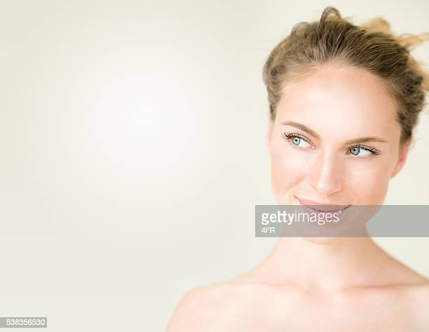cute woman looking into free copy space - green eyes stock pictures, royalty-free photos & images