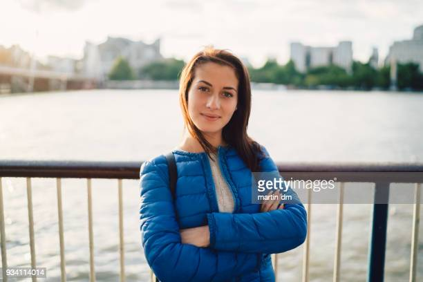 Cute woman's portrait in London standing at the Thames river